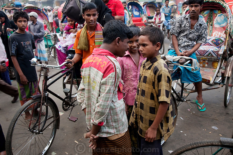 Alamin Hasan (right) confronts a rival at the Kamalapur Railway Station in Dhaka, Bangladesh, where he works as a porter.  (Featured in the book What I Eat: Around the World in 80 Diets.) MODEL RELEASED..