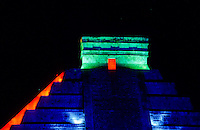 Pyramid in colorfull spotlight at night. Chichen Itza - from Yucatec Maya: Chi'ch'&egrave;en &Igrave;itsha &quot;at the mouth of the well of the Itza&quot;) is a large pre-Columbian archaeological site built by the Maya civilization located in the northern center of the Yucat&aacute;n Peninsula, in the Municipality of Tin&uacute;m, Yucat&aacute;n state, present-day Mexico...Chichen Itza was a major focal point in the northern Maya lowlands from the Late Classic through the Terminal Classic and into the early portion of the Early Postclassic period. The site exhibits a multitude of architectural styles, from what is called &quot;In the Mexican Origin&quot; and reminiscent of styles seen in central Mexico to the Puuc style found among the Puuc Maya of the northern lowlands. The presence of central Mexican styles was once thought to have been representative of direct migration or even conquest from central Mexico, but most contemporary interpretations view the presence of these non-Maya styles more as the result of cultural diffusion. foto, reise, photograph, image, images, photo,<br />