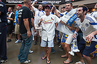 St. Louis, MO - Sunday, June 15, 2014:  St. Louis Cardinals baseball fan Daryl Schaetty is surrounded by Bosnia-Herzegovina fans watch the Bosnia vs. Argentina first round World Cup match on the big screen at Ballpark Village in downtown St. Louis.