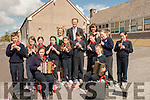 MUSICIANS: Pupils of Listellick play a tune for the Minister of Education Jan O'Sullivan TD on her arrival at Listellick NS on Thursday L-r: Front seated  Nicole Horgan and Valerie Enright. Centre Drragh Hennessy,lenia Daly,Clodagh O'Sullivan,Yamara Fitzmaurice,Amy McCarthy,Kaileigh Killian and Paddy Falvey.