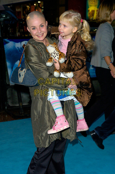 "GAIL PORTER & HONEY HIPGRAVE.Attends the European Film Premiere of ""Happy Feet"" .Empire Cinema, leicester Square, London, England,.November 26th 2006..half length kid child daughter mother family holding carrying bald.CAP/CAN.©Can Nguyen/Capital Pictures"