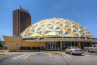 The Gold Dome building was built on the thriving Route 66 in 1958&nbsp;&nbsp;as the innovative Classen State Bank and is now owned by community leader Dr. Irene Lam of&nbsp;Bona Vision Eye Center. The historic building&nbsp;&nbsp;is the fifth geodesic dome constructed in the world,&nbsp;&nbsp;and was known for being &ldquo;one of the nation&rsquo;s most revolutionary bank designs&rdquo;. Patented by architect and futurist R. Buckminster Fuller, geodesic designs are based upon great circles, &quot;geodesics&quot; lying on the surface of a sphere; they intersect to form triangular elements which will evenly distribute stress over a great span without any additional structural support.<br /> <br /> The Gold Dome is also listed as an Oklahoma Historical Site. It is constructed of 625 gold anodized aluminum panels, ranging in size from 7.5 to 11.5 feet in length, 60 &ndash; 70 pounds in weight each, and spanning a diameter of 145 feet. The interior covers approximately 27,000 square feet, the highlight of which is the stunning interior gold dome spanning the space.&nbsp;<br /> <br /> Today, the Gold Dome is an event center, business complex and multicultural hub. &nbsp;It is open to the public and has several meeting spaces available to hold public or private events.
