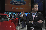A man pouts beside the 2010 Ford Taurus at the Detroit Auto Show in Detroit, Michigan on January 11, 2009.