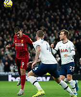 Liverpool's Roberto Firmino heads the ball despite the attentions of Tottenham's Toby Alderweireld and Christian Eriksen <br /> <br /> Photographer Stephanie Meek/CameraSport<br /> <br /> The Premier League - Tottenham Hotspur v Liverpool - Saturday 11th January 2020 - Tottenham Hotspur Stadium - London<br /> <br /> World Copyright © 2020 CameraSport. All rights reserved. 43 Linden Ave. Countesthorpe. Leicester. England. LE8 5PG - Tel: +44 (0) 116 277 4147 - admin@camerasport.com - www.camerasport.com