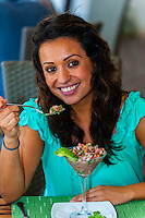 Woman eating ceviche, Le Reve Hotel, Riviera Maya, Quintana Roo, Mexico
