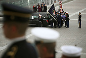The flag-draped casket of former President George H.W. Bush is placed into a hearse by a joint services military honor guard at the U.S. Capitol Wednesday, Dec. 5, 2018, in Washington.<br /> Credit: Win McNamee / Pool via CNP