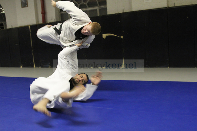 The UK judo club demonstrates some of their moves in the Alumni Gym, where they practice. Photo by Brandon Goodwin | Staff