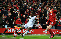 24th February 2020; Anfield, Liverpool, Merseyside, England; English Premier League Football, Liverpool versus West Ham United; Michail Antonio of West Ham United cuts the ball back across the goal line as Andy Robertson of Liverpool attempts to block