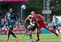 James Berrett of York City beats Luke O'Nien of Wycombe Wanderers to the ball as Marcus Bean of Wycombe Wanderers looks on during the Sky Bet League 2 match between Wycombe Wanderers and York City at Adams Park, High Wycombe, England on 8 August 2015. Photo by Andy Rowland.