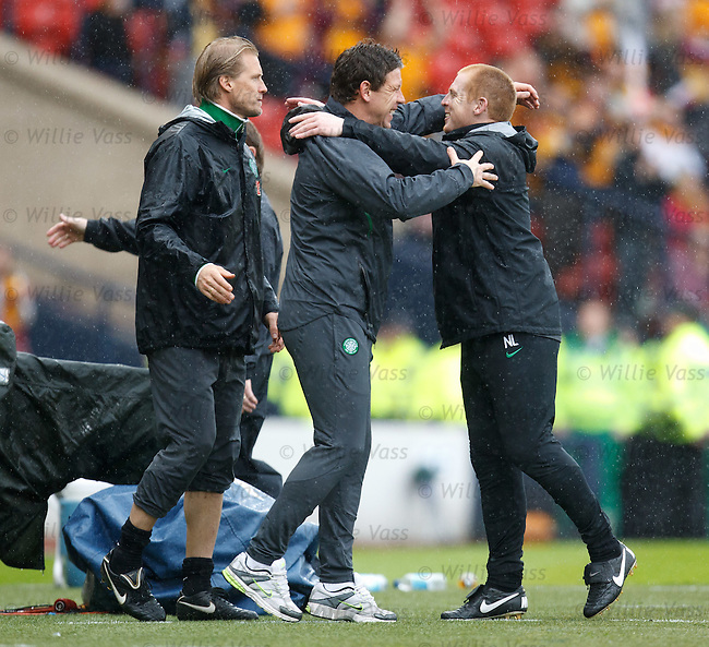 Neil Lennon turns and hugs Alan Thompson and Johan Mjallby at the full time whistle