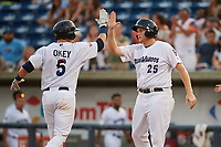 Pensacola Blue Wahoos Shrimp catcher Chris Okey (5) high fives with Gavin LaValley (25) after hitting a home run in the bottom of the third inning during a game against the Jacksonville Jumbo on August 15, 2018 at Blue Wahoos Stadium in Pensacola, Florida.  Jacksonville defeated Pensacola 9-2.  (Mike Janes/Four Seam Images)