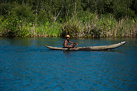 Africa, Madagascar, Canal des Pangalanes.. Man paddling pirogue, traditional dug out canoe.