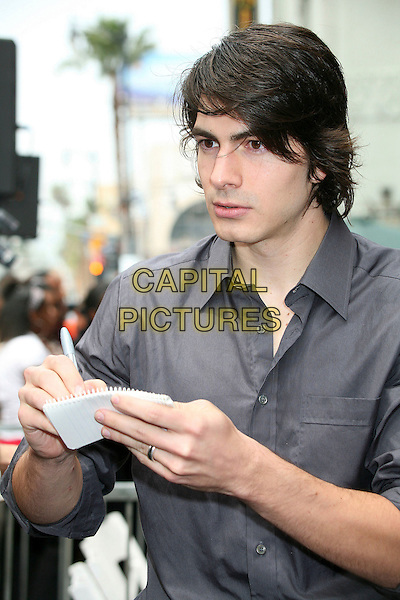 BRANDON ROUTH.Producer Jon Peters Honored with a Star on the Hollywood Walk of Fame in front of Grauman's Chinese Theatre, Hollywood, California, USA,.1 May 2007..half length signing autograph grey shirt.CAP/ADM/BP.©Byron Purvis/AdMedia/Capital Pictures.