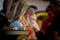 4-moth old Genevieve Marie Johnson takes in her first championship Victory Lane though it is her father's fifth.