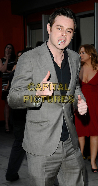 "DANNY DYER .At the ""City Rats"" East End Film Festival VIP Screening, Genesis Cinema, Mile End Road, London, England, UK, .April 24th 2009..half length smoking cigarette grey gray suit  thumb up .CAP/CAN.©Can Nguyen/Capital Pictures"
