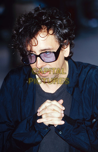 TIM BURTON.Ref: 11003.sunglasses, shades, hands.www.capitalpictures.com.sales@capitalpictures.com.© Capital Pictures.