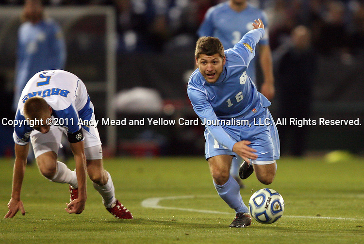 09 December 2011: North Carolina's Enzo Martinez (16) and UCLA's Andy Rose (ENG) (5). The University of California Los Angeles Bruins played the University of North Carolina Tar Heels to a 2-2 tie after overtime, with the Tar Heels advancing with a 3-1 win in the penalty kick shootout at Regions Park in Hoover, Alabama in an NCAA Division I Men's Soccer College Cup semifinal game.