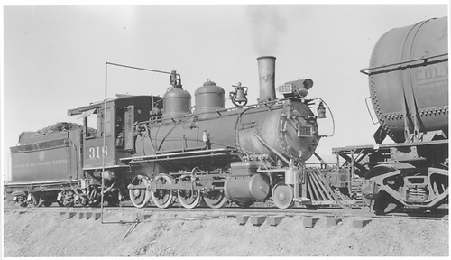 3/4 engineer's-side view of D&amp;RGW #318 furnishing steam for heating the contents of the nearby tank car from a pipe connected to the steam dome, probably at Alamosa.<br /> D&amp;RGW  Alamosa, CO