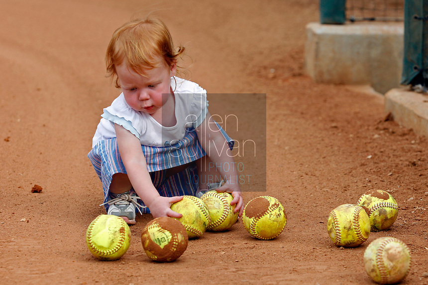 Emma, one of UGA softball coach Lu Harris-Champer's twin daughters, plays at the softball stadium on Wednesday, May 17, 2006. Harris-Champer and her husband, assistant swimming coach Jerry Champer, are expecting another daughter early next week.