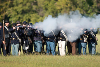 NWA Democrat-Gazette/BEN GOFF @NWABENGOFF<br /> Union soldiers fire a volley at Confederate soldiers on Friday Sept. 25, 2015 during the Battle of Pea Ridge Civil War reenactment at Webb Farm near Pea Ridge. The event continues with battle reenactments at 2:00p.m. on Saturday and at 11:00a.m. Sunday.