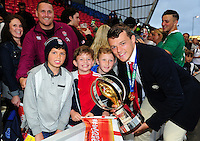 Zach Mercer of England U20 poses for a photo with his family and the World Rugby U20 Championship trophy. World Rugby U20 Championship Final between England U20 and Ireland U20 on June 25, 2016 at the AJ Bell Stadium in Manchester, England. Photo by: Patrick Khachfe / Onside Images