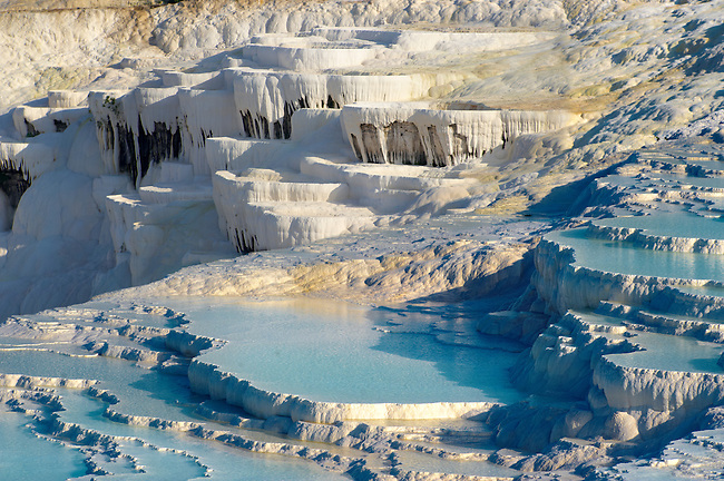 Photo  of Pamukkale Travetine Terrace, Turkey. Images of the white Calcium carbonate rock formations. Buy as stock photos or as photo art prints. 9 Pamukkale travetine terrace water cascades, composed of white Calcium carbonate rock formations, Pamukkale, Anatolia, Turkey