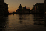Silhouetted outline of San Maria della Salute on the Grand Canal at dawn,showing scaffolding, May 2007. Venice, Italy.