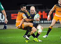 Jeronimo De La Fuente tackles Matt Faddes during the Super Rugby match between the Highlanders and Jaguares at Forsyth Barr Stadium in Dunedin, New Zealand on Saturday, 11 May 2019. Photo: Dave Lintott / lintottphoto.co.nz