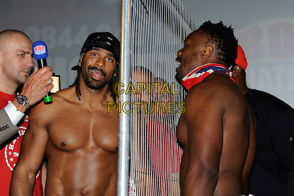 David Haye and Dereck Chisora .David Haye and Dereck Chisora Weigh-In at The Odeon Leicester Square, London, England. .July 12th, 2012.half length fence side profile chest topless bandana goatee facial hair  .CAP/IA.©Ian Allis/Capital Pictures.