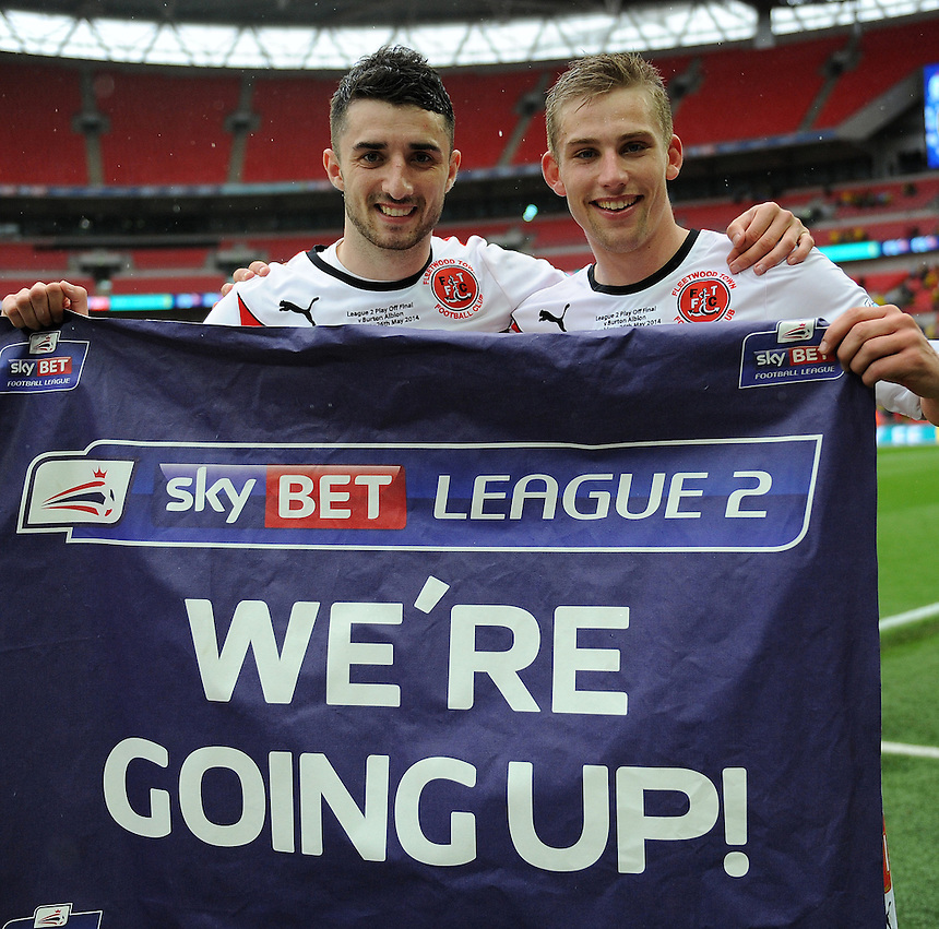 Fleetwood Town's Conor McLaughlin and Charlie Taylor celebrate winning promotion to league 1 <br /> <br /> Photographer Ian Cook/CameraSport<br /> <br /> Football - The Football League Sky Bet League Two Play-Off Final - Burton Albion v Fleetwood Town - Mondat 26th May-2014 - Wembley Stadium - London<br /> <br /> &copy; CameraSport - 43 Linden Ave. Countesthorpe. Leicester. England. LE8 5PG - Tel: +44 (0) 116 277 4147 - admin@camerasport.com - www.camerasport.com