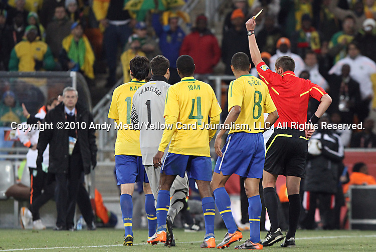 20 JUN 2010:  Kaka (BRA)(left of pack) is shown his second yellow card caution of the match as Referee Stephane Lannoy (FRA) reaches in his rear pocket for the red card as teammates Gilberto Silva (BRA)(8), Juan (BRA)(4), and Julio Cesar (BRA)(1) gather around.  The Brazil National Team defeated the C'ote d'Ivoire National Team 3-1 at the end of the first half at Soccer City Stadium in Johannesburg, South Africa in a 2010 FIFA World Cup Group G match.