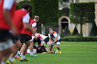 Chris Cook of Bath Rugby looks to pass the ball. Bath Rugby training session on September 4, 2015 at Farleigh House in Bath, England. Photo by: Patrick Khachfe / Onside Images