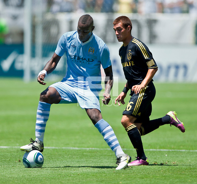 CARSON, CA – July 24, 2011: Manchester City player Mario Balotelli (45) and LA Galaxy player Hector Jimenez (16) during the match between LA Galaxy and Manchester City FC at the Home Depot Center in Carson, California. Final score Manchester City FC 1 and LA Galaxy 1. Manchester City wins shoot out 7, LA Galaxy 6.