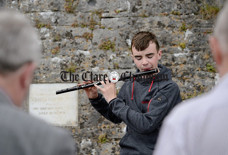 Local musician James Kelly plays a tune at a commemorative service in Kilchreest cemetery to mark the one hundredth anniversary of the death of local man John Jacko Browne who was killed in the First World War and is buried in Saulty, France. Photograph by John Kelly.