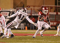 NWA Democrat-Gazette/MICHAEL WOODS • University of Arkansas running back Alex Collins slips past Mississippi defender Mark McLaurin for a gain in the 3rd quarter of Saturday nights game at Razorback Stadium November 21, 2015.