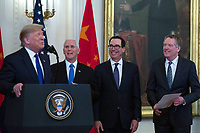 United States Vice President Mike Pence, United States Secretary of the Treasury Steven T. Mnuchin, and United States Trade Representative Robert Lighthizer laugh as United States President Donald J. Trump delivers remarks prior to he and Liu He, China's vice premier, signing a trade agreement between the United States and China in the East Room of the White House in Washington D.C., U.S., on Wednesday, January 15, 2020.  <br /> <br /> Credit: Stefani Reynolds / CNP/AdMedia