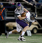 SIOUX FALLS, SD - OCTOBER 4: Brady Rose #5 from the University of Sioux Falls bounces off defender Jordan Nieuwsma #25 from Concordia St. Paul in the first half of their game Saturday evening at Bob Young Field.(Photo by Dave Eggen/Inertia)