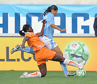#11 Christiane of the Chicago Red Stars loses control of the ball against  # 5 Anita Asante  of Sky Blue FC  Sky Blue FC beat the Red Star 2-0.