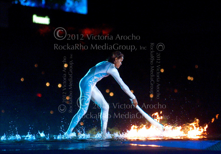 Australian Olympic athlete Cathy Freeman ignites the Olympic flame during the opening ceremony for the Summer Olympics Friday, Sept. 15, 2000, at Olympic Stadium in Sydney. (AP Photo/Victoria Arocho)