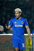 Lyle Taylor of AFC Wimbledon remonstrates with officials during the Sky Bet League 1 match between AFC Wimbledon and Charlton Athletic at the Cherry Red Records Stadium, Kingston, England on 10 April 2018. Photo by Carlton Myrie / PRiME Media Images.