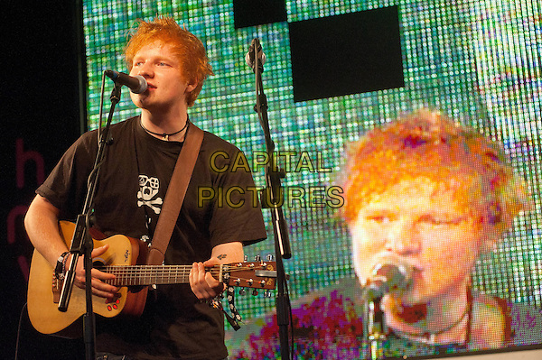 Ed Sheeran.Performing live and then signing copies of his new album '+' at HMV Oxford Circus, London, England..September 12th, 2011.half length black top guitar stage performance live gig singing.CAP/HT.©Hugh Thompson/Capital Pictures.