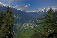 View of Fliess village with pastures  in the valley and mountains in the background. Imst district, Tyrol/ Tirol, Austria.