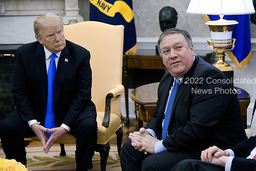 Secretary of State Mike Pompeo (R) attends a meeting between U.S. President Donald Trump and Pastor Andrew Brunson in the Oval Office of the White House on October 13, 2018 in Washington, DC. Pastor Andrew Brunson arrived back in the U.S. on Saturday after being held in Turkey for two years on terrorism charges. <br /> Credit: Olivier Douliery / Pool via CNP