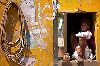 Indian man at his home and business at Ganesh Dham in Sawai Madhopur district in Rajasthan, Northern India