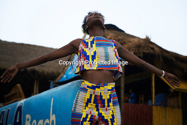 ACCRA, GHANA – APRIL 21: A model wears a creation by the Ghanaian/American designers Osei-Duro on April 21, 2015 at a beach club in Accra, Ghana.  (Photo by: Per-Anders Pettersson)