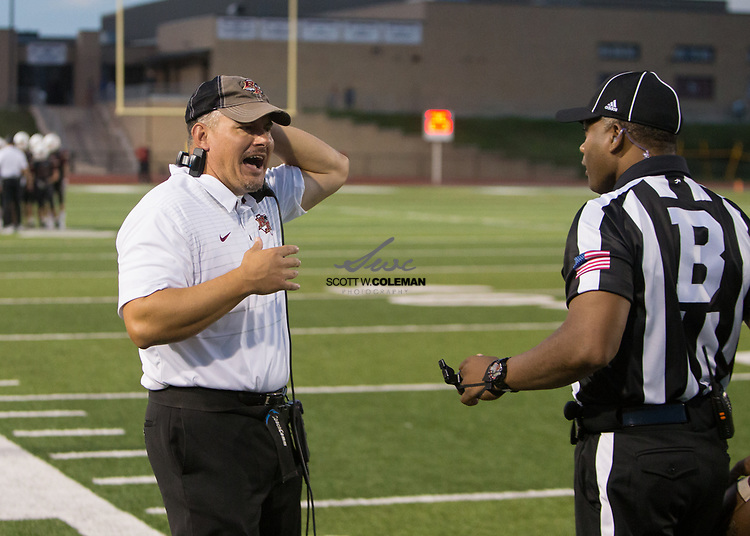Rouse Raiders head coach Joshua Mann during a high school football game between the Rouse Raiders and the East View Patriots at A.C. Bible Stadium in Leander, Texas, on Friday, September 15, 2017.