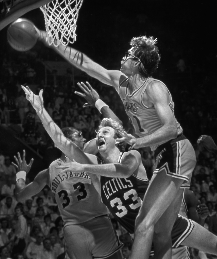 NBA Finals in which the Los Angeles Lakers put down Boston's Larry Bird in a last ditch flailing attempt to get to the rim. copyright, Orange County Register/Jim Mendenhall