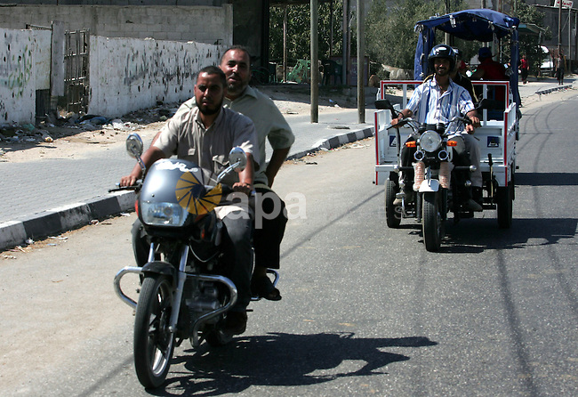 Palestinians train to ride motorcycles in the southern Gaza Strip town of  Rafah on July 19,2010, as Gaza police required licenses to ride motorcycles because of the large number of accidents which happened in the enclave Strip. motorcycles smuggled into the Gaza Strip through tunnels between Egypt and Gaza Strip. Photo by Khaled Khaled