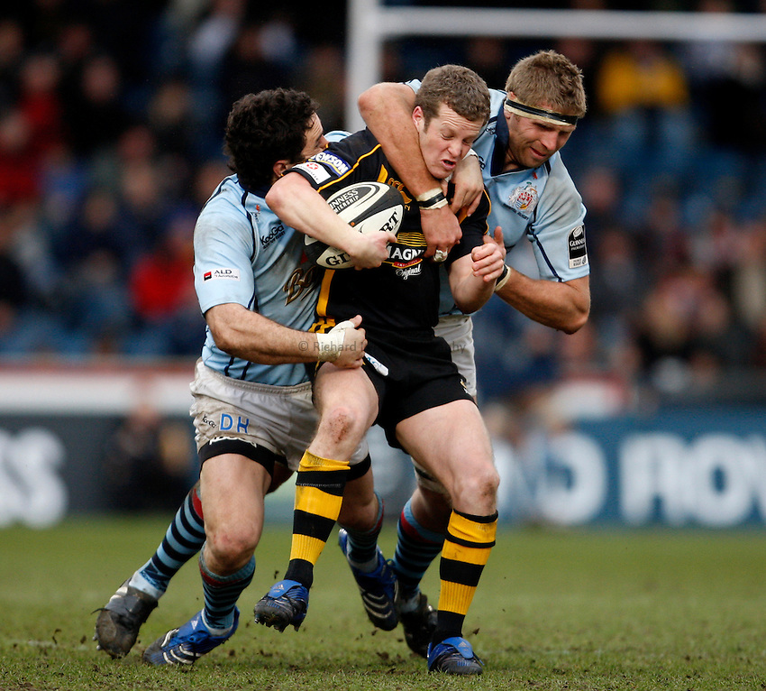 Photo: Richard Lane/Richard Lane Photography. .London Wasps v Bristol Rugby. Guinness Premiership. 23/02/3008. Wasps' Dave Walder is tackled by Bristol's David Hill and Sean Hohneck.