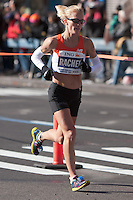 NEW YORK - NOVEMBER 7: Rachel Booth of the USA approaches the 8 mile mark on 4th avenue in the 2010 New York City Marathon. Booth finished 31st in 2:43:36.